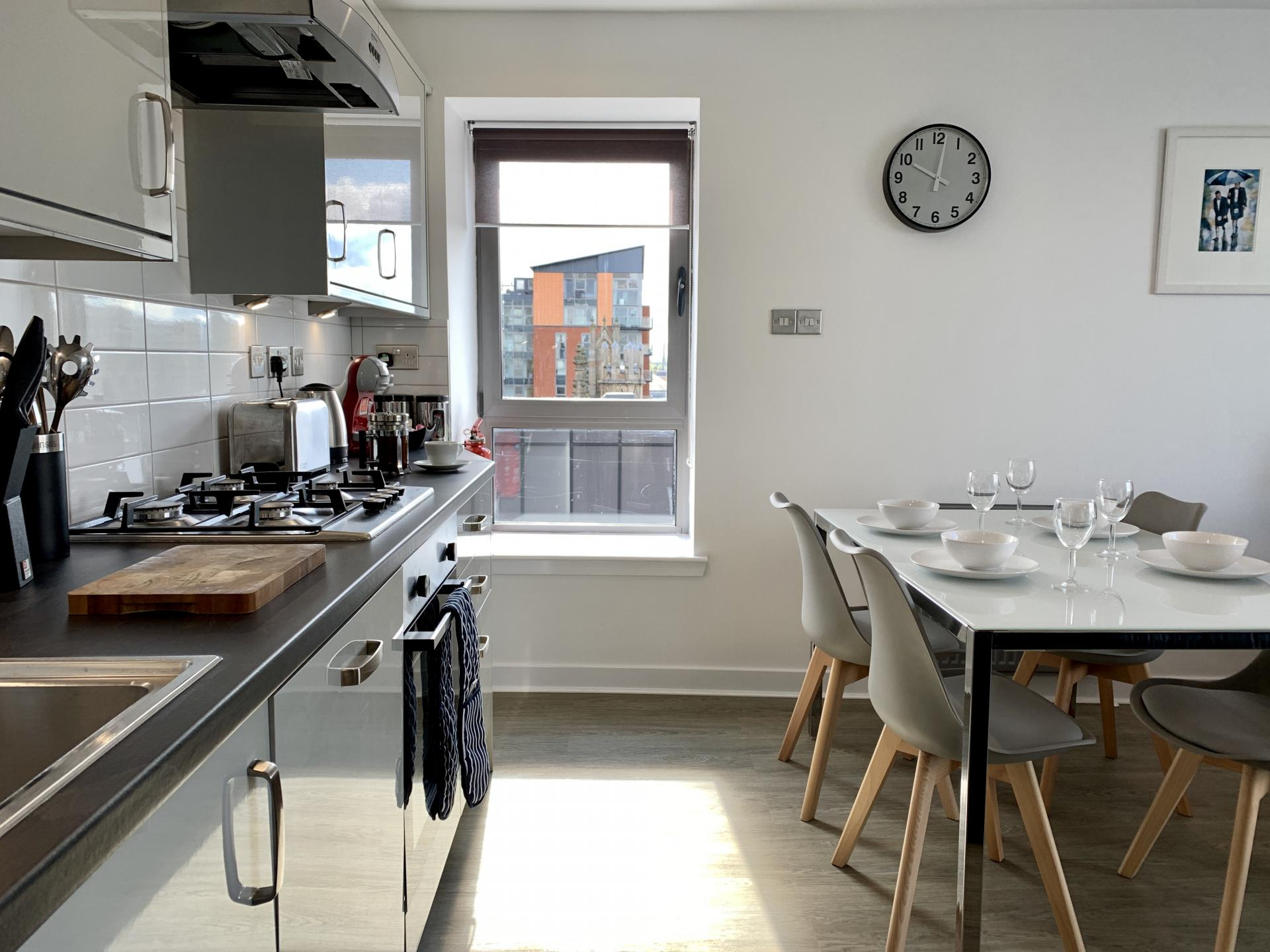 Fully equipped kitchen at Clyde Waterfront Apartment - Citybase Apartments