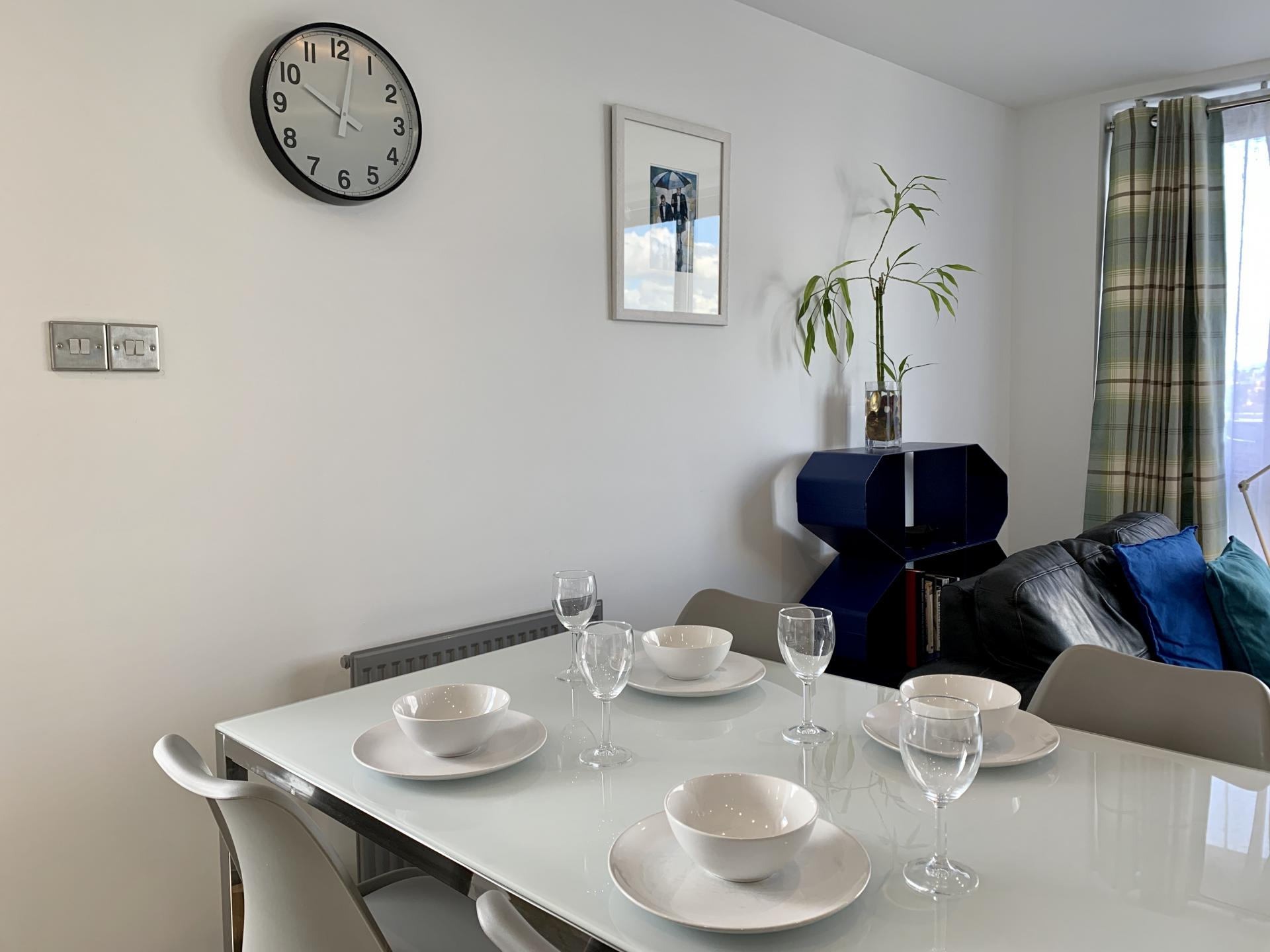 Dining table Bright living area at Clyde Waterfront Apartment - Citybase Apartments
