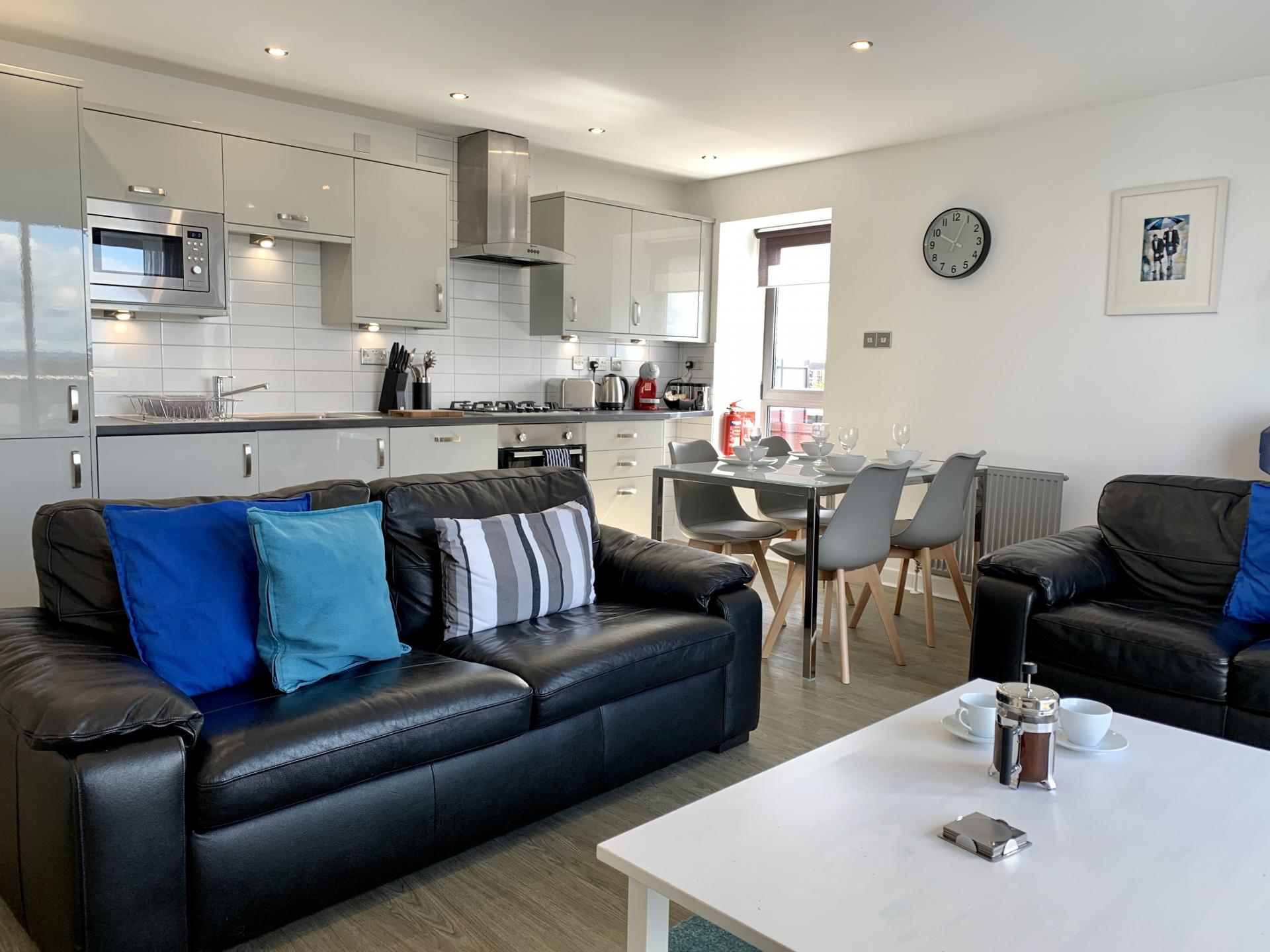 Bright living area at Clyde Waterfront Apartment - Citybase Apartments