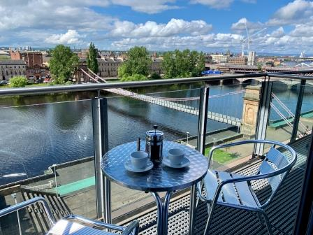Balcony at Clyde Waterfront Apartment - Citybase Apartments