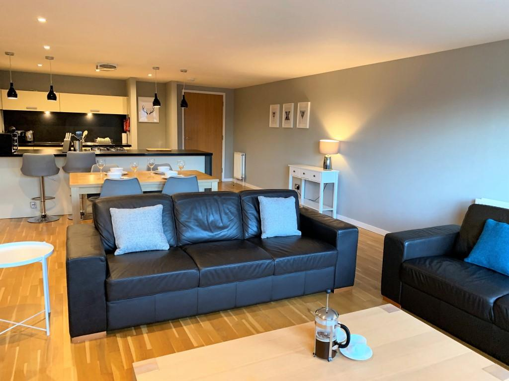 Sofa area at Tolbooth Apartments - Citybase Apartments
