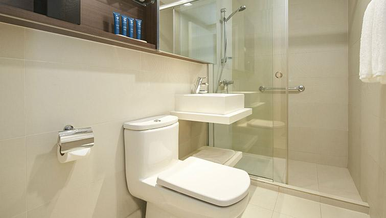 Shower and toilet at PARKROYAL Serviced Suites Singapore - Citybase Apartments