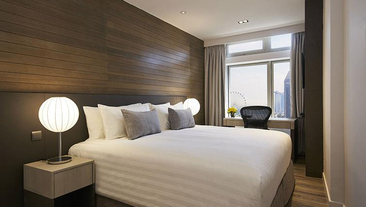 King bed at PARKROYAL Serviced Suites Singapore - Citybase Apartments