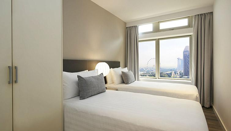 Twin bedroom at PARKROYAL Serviced Suites Singapore - Citybase Apartments