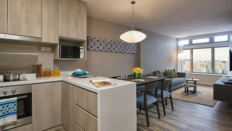 Kitchen counter and dining area at PARKROYAL Serviced Suites Singapore - Citybase Apartments