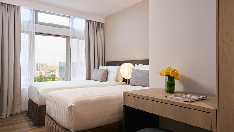 Twin beds at PARKROYAL Serviced Suites Singapore - Citybase Apartments