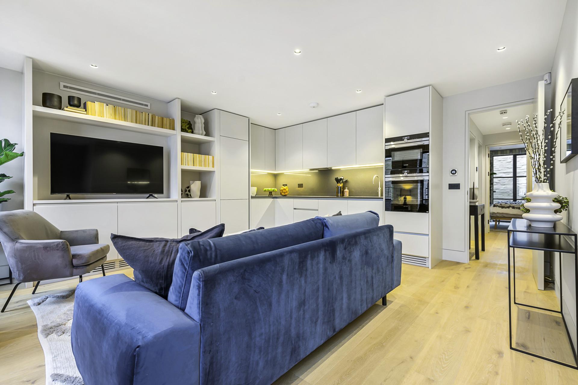 Blue sofa at King's Mews Apartments, Holborn, London - Citybase Apartments