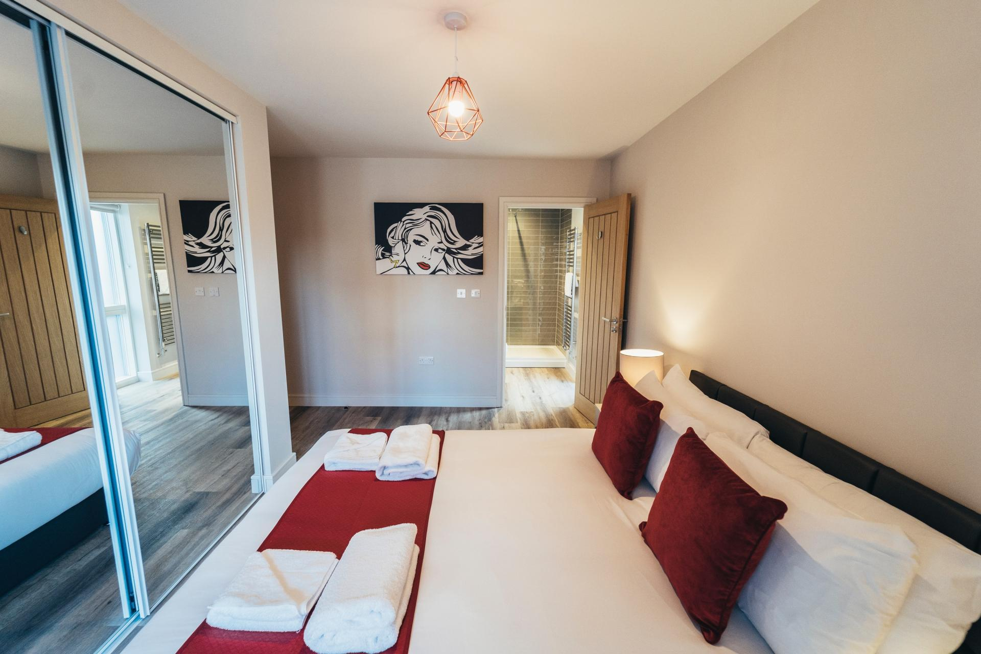 White and red bed at Devonshire Court Apartments, West Bridgford, Nottingham - Citybase Apartments