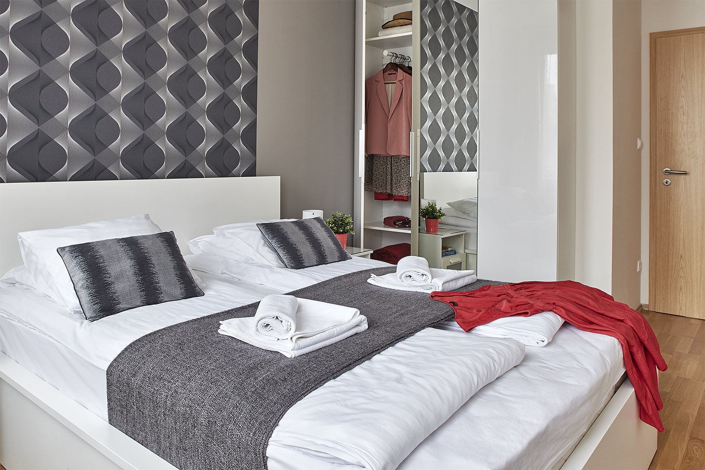 Comfortable bedroom at 7 Seasons Apartments - Citybase Apartments