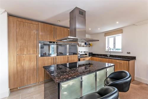 Kitchen island at Chester Racecourse Apartments - Citybase Apartments