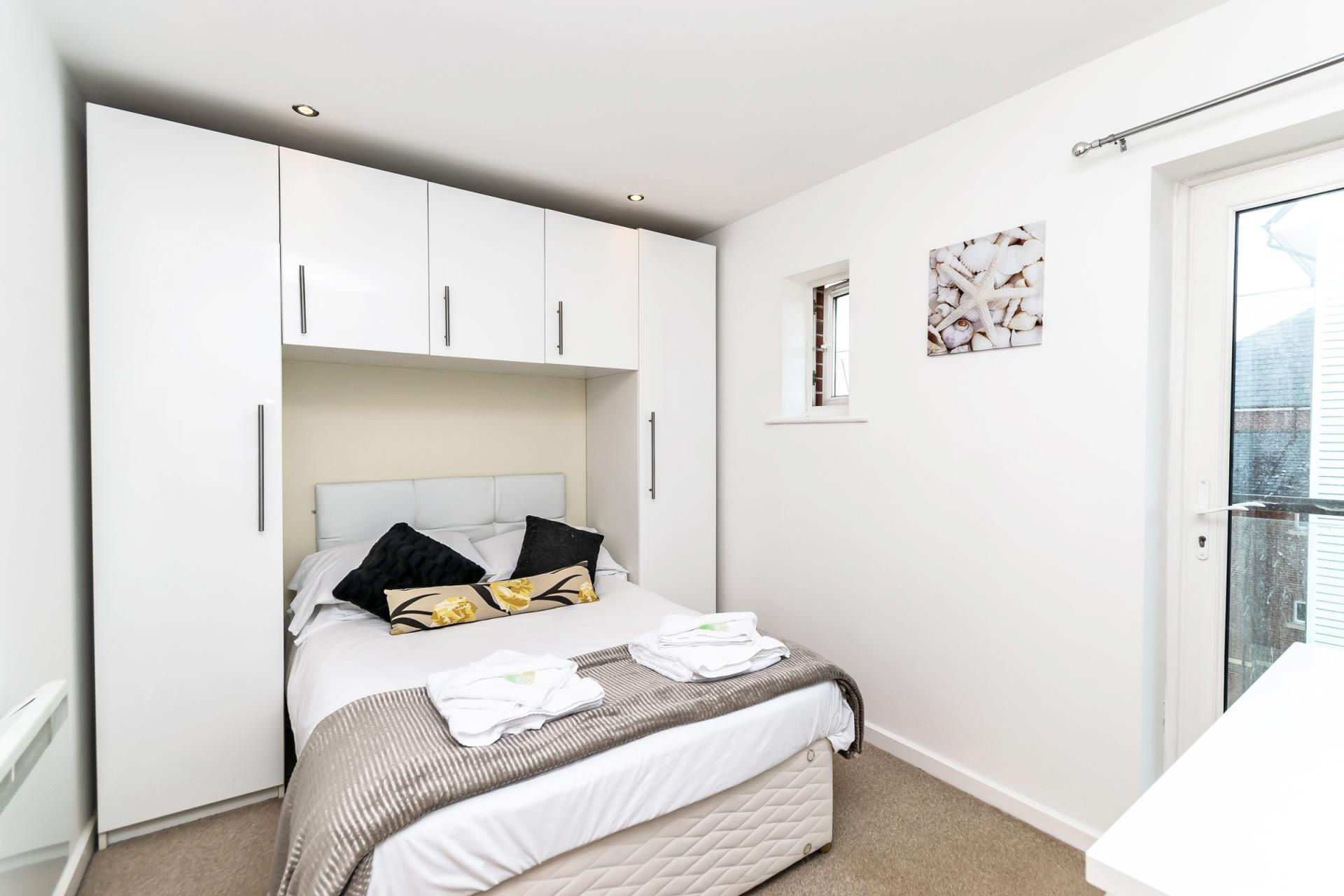 Cosy bedroom at Chester Racecourse Apartments - Citybase Apartments