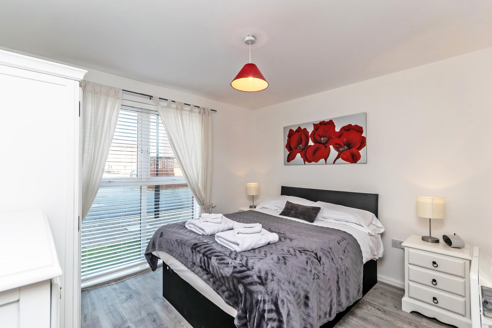 Comfortable bedroom at Chester Racecourse Apartments - Citybase Apartments