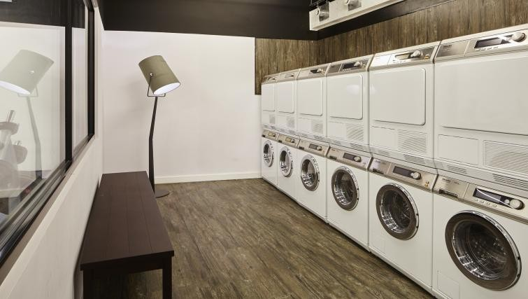 Communal laundry at Residence Inn London Kensington, Earls Court, London - Citybase Apartments