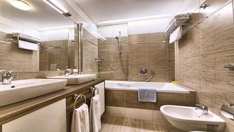 Stylish bathroom at Residence Brehova Apartments - Citybase Apartments