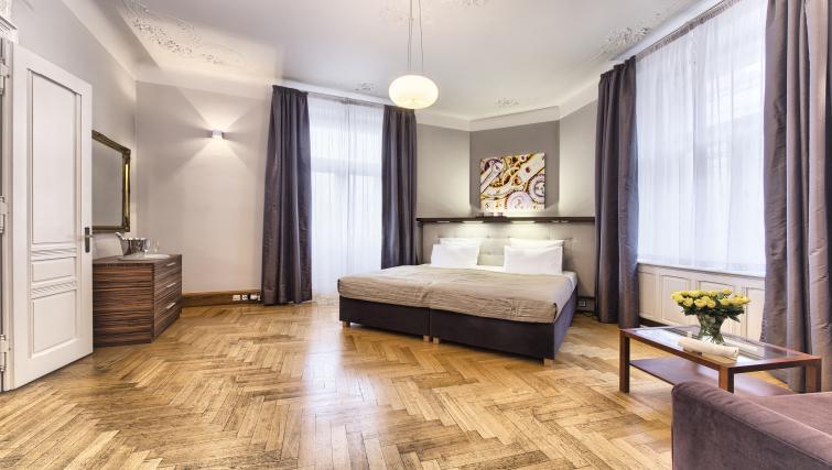 Spacious bedroom at Residence Brehova Apartments - Citybase Apartments