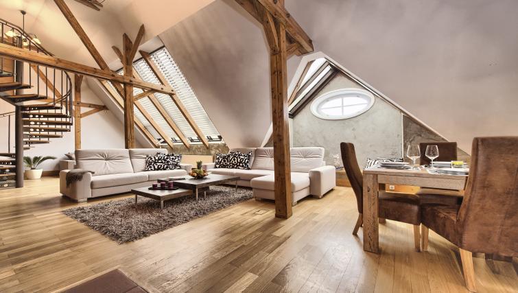 Stylish living area at Residence Brehova Apartments - Citybase Apartments