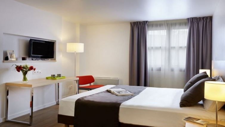 Comfortable living area in Citadines Presqu'ile Apartments - Citybase Apartments