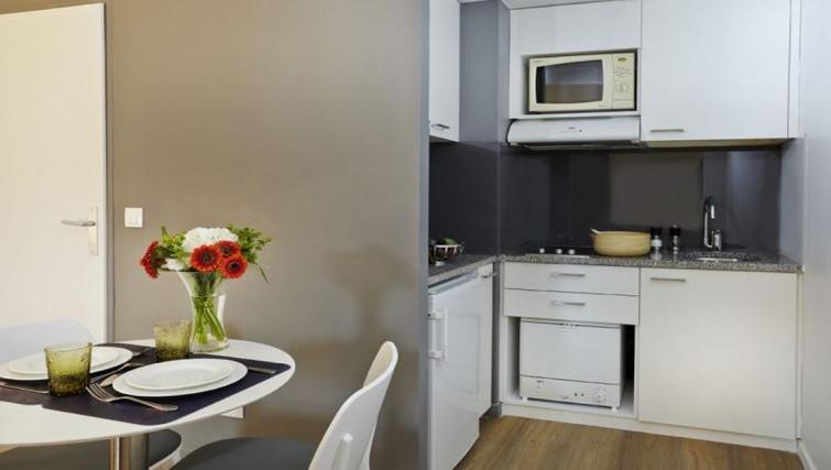 Modest kitchen in Citadines Presqu'ile Apartments - Citybase Apartments