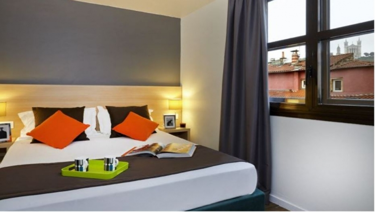 Charming bedroom in Citadines Presqu'ile Apartments - Citybase Apartments
