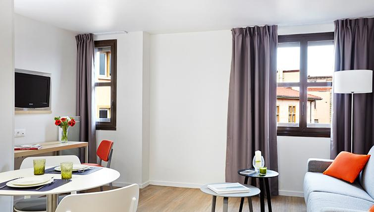 Living area at Citadines Presqu'ile Apartments - Citybase Apartments