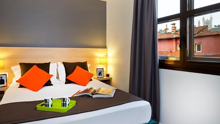 Bedroom at Citadines Presqu'ile Apartments - Citybase Apartments