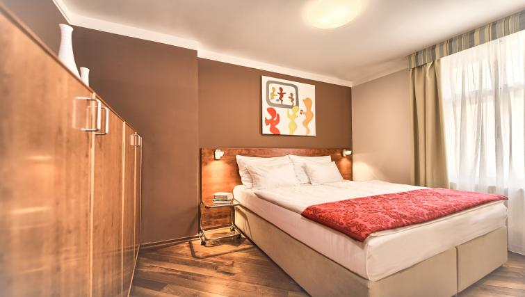 Cosy bedroom at Residence Masna Apartments - Citybase Apartments