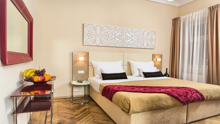 Bed at Residence Karolina Apartments - Citybase Apartments