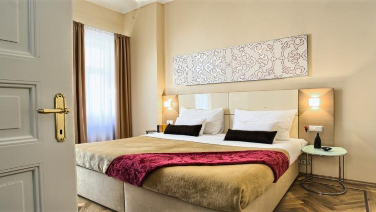 Comfy bed at Residence Karolina Apartments - Citybase Apartments