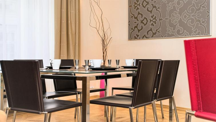 Dining area at Residence Karolina Apartments - Citybase Apartments