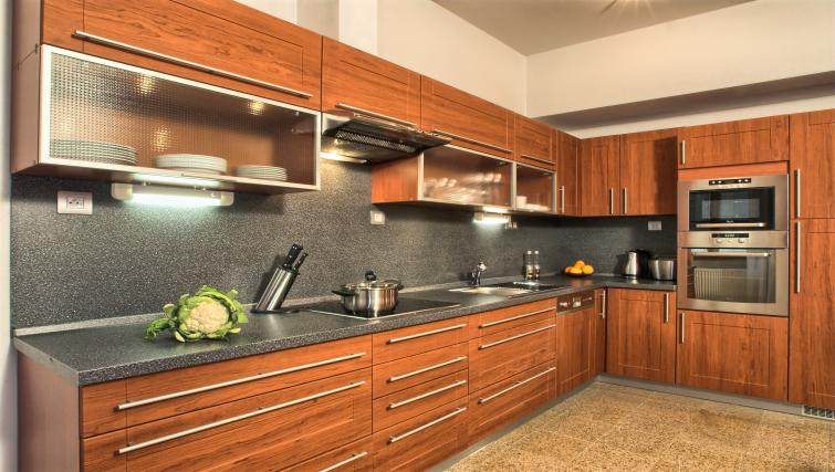 Fully equipped kitchen at Residence Rybna Apartments - Citybase Apartments