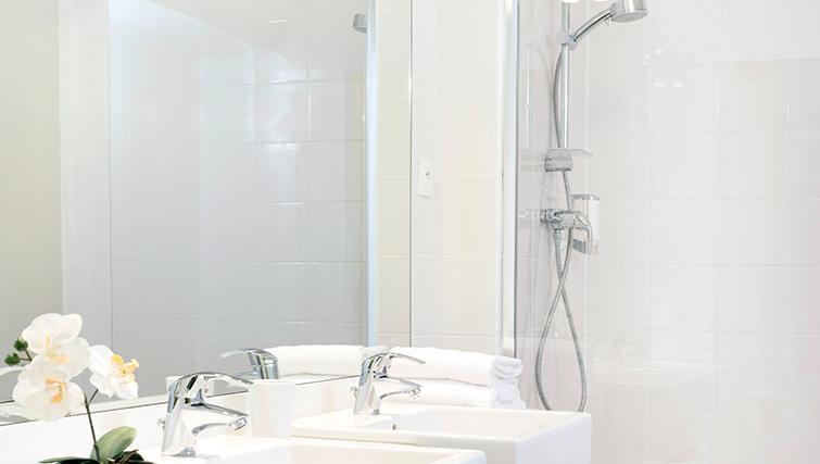 Pristine bathroom at Citadines Lille Centre Apartments - Citybase Apartments