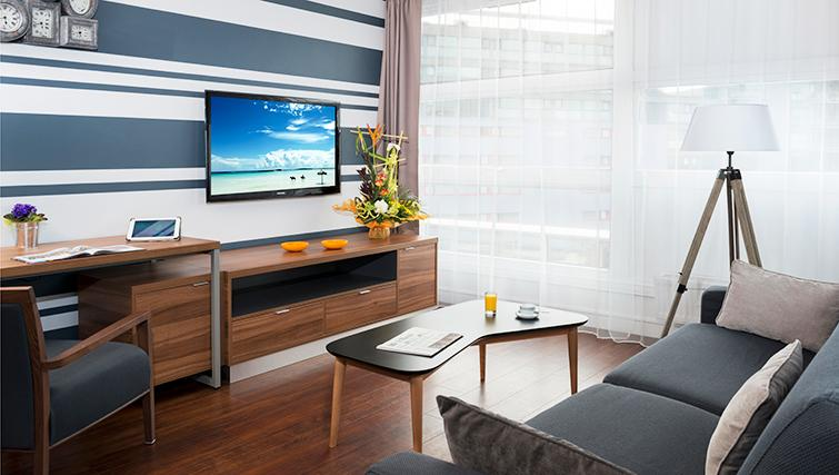 Spacious living area at Citadines Lille Centre Apartments - Citybase Apartments