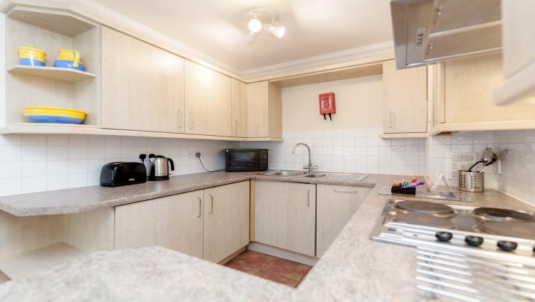Kitchen at King Regents Fitzroy Apartments - Citybase Apartments