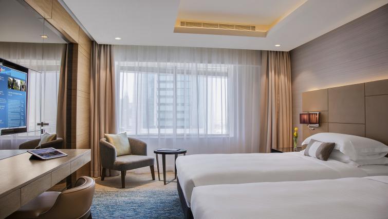 Bed at Towers Rotana Apartments - Citybase Apartments