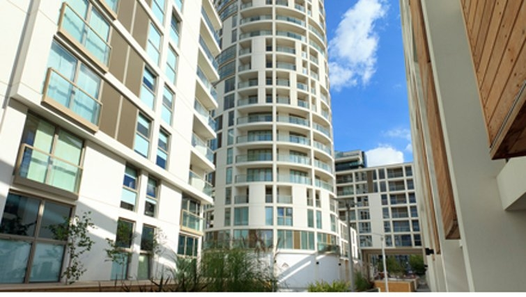 Graceful exterior to SACO Canary Wharf Trinity Tower - Citybase Apartments