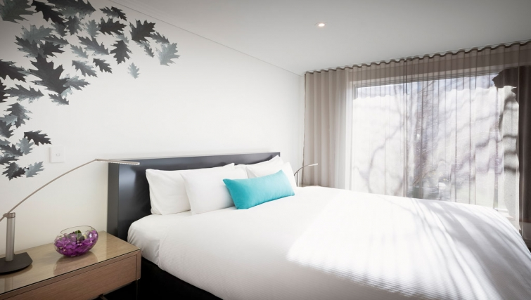 Tidy bedroom in The Como Melbourne Apartments - Citybase Apartments