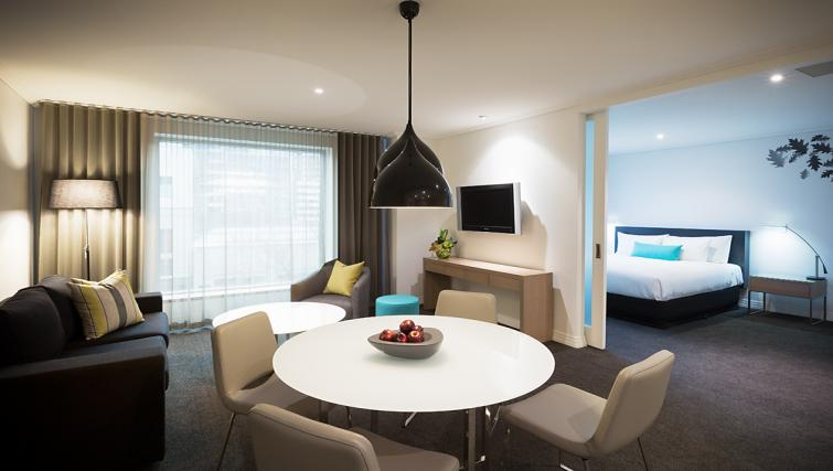Living/dining area at The Como Melbourne Apartments - Citybase Apartments