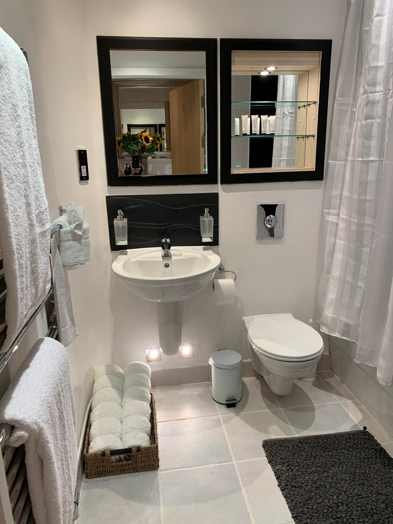 Bathroom at Millharbour Apartment, Canary Wharf, London - Citybase Apartments