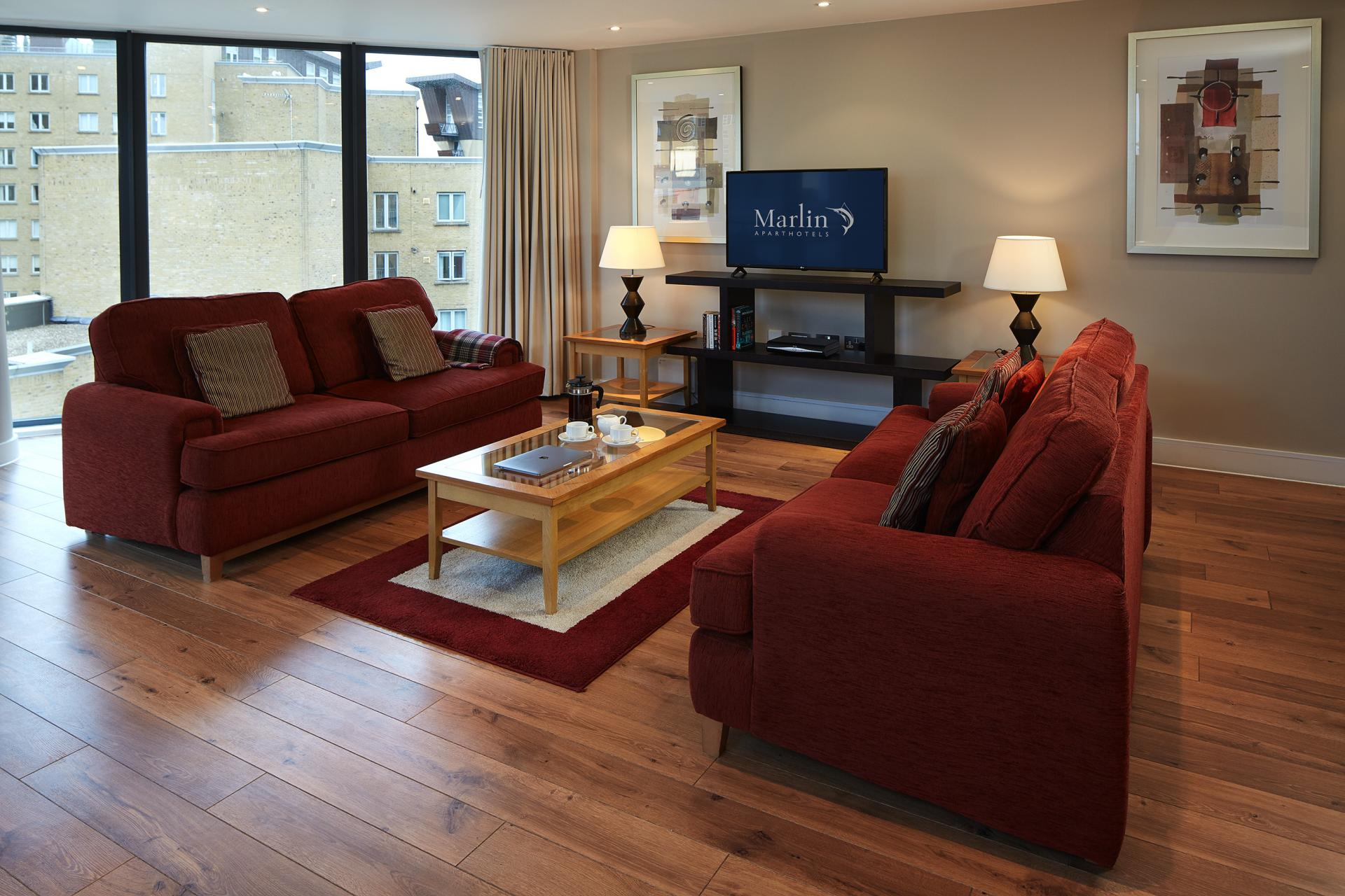 Living area at Marlin Canary Wharf Apartments, Canary Wharf, London - Citybase Apartments