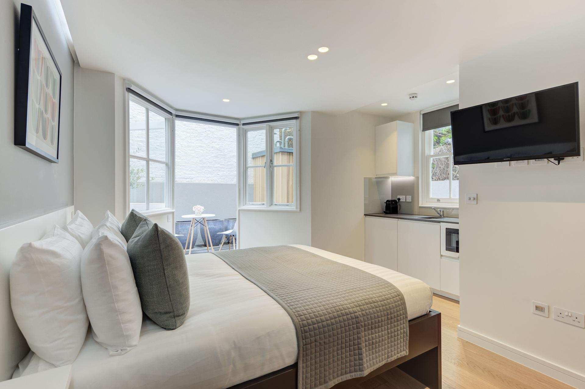 Bright bedroom at Inverness Terrace Apartments, Bayswater, London - Citybase Apartments