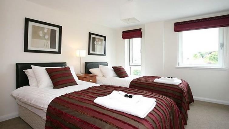 Bright bedroom at Kepplestone Manor - Citybase Apartments