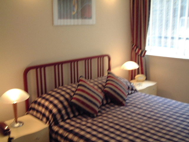 Cosy bedroom at King Regents Place Apartments - Citybase Apartments