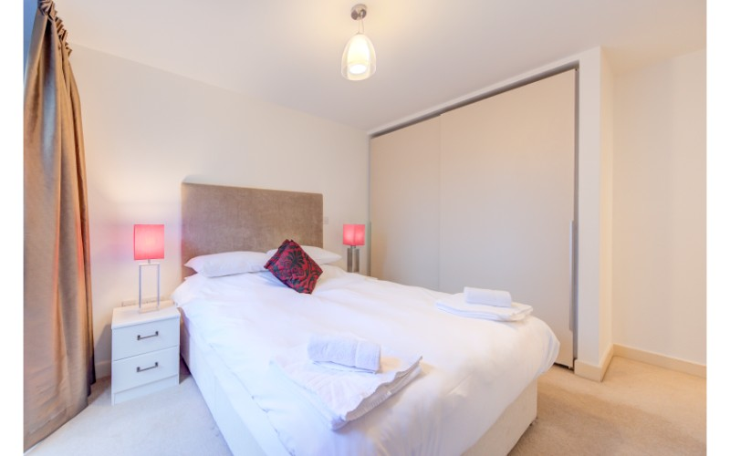 Bright bedroom at Finzels Reach Apartments - Citybase Apartments