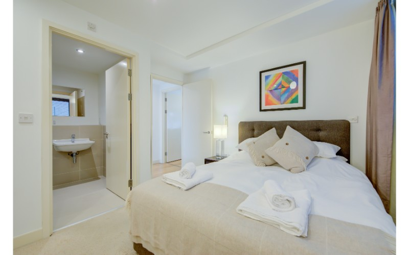 Comfortable bed at Finzels Reach Apartments - Citybase Apartments