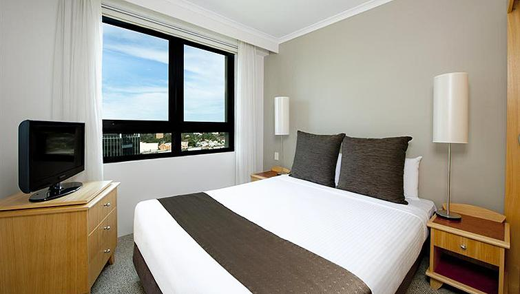 Compact bedroom at Mantra Parramatta - Citybase Apartments