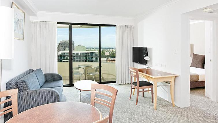 Open-plan living area at Mantra Parramatta - Citybase Apartments