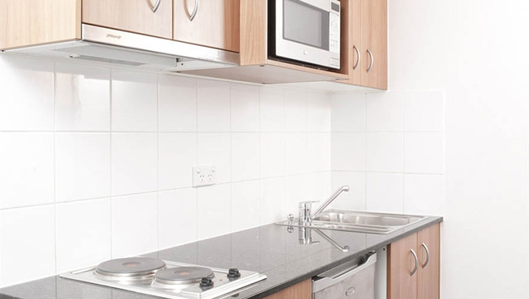 Compact kitchen at Mantra Parramatta - Citybase Apartments