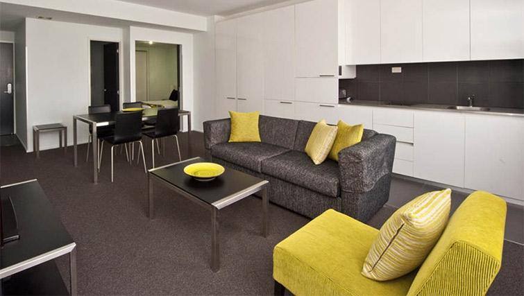 Spacious living area at Mantra 100 Exhibition - Citybase Apartments