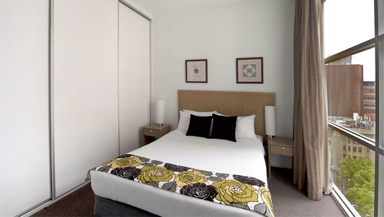 Scenic bedroom at Mantra 100 Exhibition - Citybase Apartments