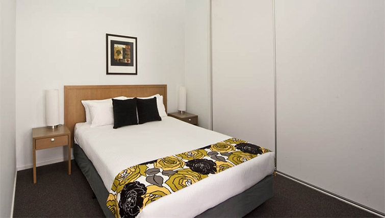 Tasteful bedroom at Mantra 100 Exhibition - Citybase Apartments